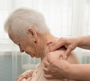 Old woman having a massage
